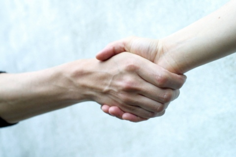 Businessmen shaking hands - CT Business Solutions